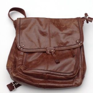 Warm brown leather backpack, from thesak